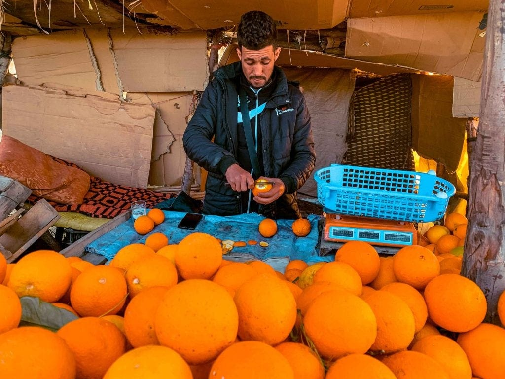 Orange vendor Chefchaouen